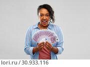 Купить «surprised african american woman with euro money», фото № 30933116, снято 2 марта 2019 г. (c) Syda Productions / Фотобанк Лори