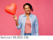Купить «african american woman with heart-shaped balloon», фото № 30933136, снято 2 марта 2019 г. (c) Syda Productions / Фотобанк Лори