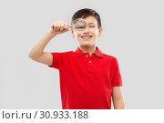Купить «smiling boy looking through magnifying glass», фото № 30933188, снято 9 марта 2019 г. (c) Syda Productions / Фотобанк Лори