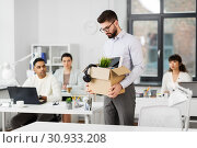 sad fired male office worker with personal stuff. Стоковое фото, фотограф Syda Productions / Фотобанк Лори