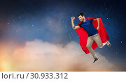 Купить «man in red superhero cape flying over night sky», фото № 30933312, снято 3 февраля 2019 г. (c) Syda Productions / Фотобанк Лори