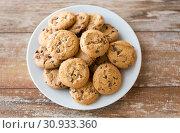 Купить «close up of oatmeal cookies on plate», фото № 30933360, снято 22 мая 2015 г. (c) Syda Productions / Фотобанк Лори