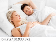 Купить «happy couple sleeping in bed at home», фото № 30933372, снято 25 февраля 2016 г. (c) Syda Productions / Фотобанк Лори