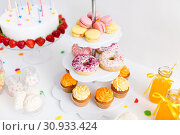 Купить «close up of stand with sweets at birthday party», фото № 30933424, снято 6 июля 2018 г. (c) Syda Productions / Фотобанк Лори