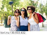 Купить «women with shopping bags taking selfie outdoors», фото № 30933432, снято 22 июля 2018 г. (c) Syda Productions / Фотобанк Лори