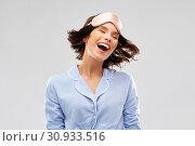Купить «happy young woman in pajama and eye sleeping mask», фото № 30933516, снято 6 марта 2019 г. (c) Syda Productions / Фотобанк Лори