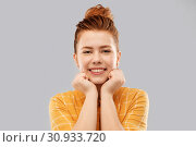 Купить «smiling red haired teenage girl in checkered shirt», фото № 30933720, снято 28 февраля 2019 г. (c) Syda Productions / Фотобанк Лори