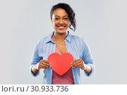Купить «happy african american woman with red heart», фото № 30933736, снято 2 марта 2019 г. (c) Syda Productions / Фотобанк Лори