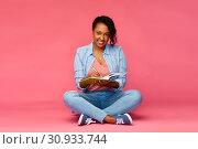 Купить «african student woman writing to diary or notebook», фото № 30933744, снято 2 марта 2019 г. (c) Syda Productions / Фотобанк Лори