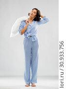 Купить «happy sleepy woman in blue pajama holding pillow», фото № 30933756, снято 6 марта 2019 г. (c) Syda Productions / Фотобанк Лори