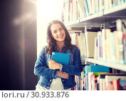 Купить «high school student girl reading book at library», фото № 30933876, снято 19 июня 2016 г. (c) Syda Productions / Фотобанк Лори