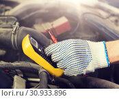 Купить «auto mechanic man with multimeter testing battery», фото № 30933896, снято 1 июля 2016 г. (c) Syda Productions / Фотобанк Лори