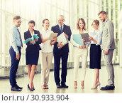 Купить «business team with tablet pc and folders at office», фото № 30933904, снято 3 июля 2016 г. (c) Syda Productions / Фотобанк Лори