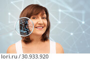 Купить «senior woman with low poly grid in magnifier», фото № 30933920, снято 8 февраля 2019 г. (c) Syda Productions / Фотобанк Лори