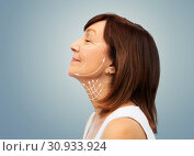 Купить «profile of senior woman with face lifting arrows», фото № 30933924, снято 8 февраля 2019 г. (c) Syda Productions / Фотобанк Лори