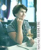 Купить «Woman with wine at restaurant», фото № 30934116, снято 23 августа 2019 г. (c) Яков Филимонов / Фотобанк Лори