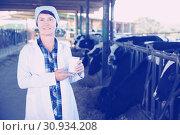 Купить «Portrait of woman quality expert who is standing», фото № 30934208, снято 24 октября 2017 г. (c) Яков Филимонов / Фотобанк Лори