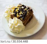 Купить «Chocolate cake with whipped cream», фото № 30934448, снято 25 июня 2019 г. (c) Яков Филимонов / Фотобанк Лори