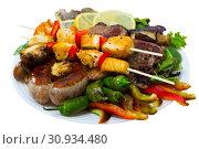 Купить «Meshana Scar, dish of bulgarian cuisine with assortiment meat and vegetables», фото № 30934480, снято 18 июля 2019 г. (c) Яков Филимонов / Фотобанк Лори