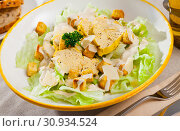 Купить «Caesar salad with grilled chicken on a white plate», фото № 30934524, снято 20 июля 2019 г. (c) Яков Филимонов / Фотобанк Лори