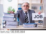 Купить «Aged male employee unhappy with excessive work», фото № 30935064, снято 15 марта 2019 г. (c) Elnur / Фотобанк Лори