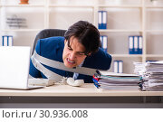 Купить «Young tied male employee in the office», фото № 30936008, снято 18 декабря 2018 г. (c) Elnur / Фотобанк Лори