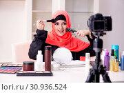 Купить «Beauty blogger in hijab recording video for her blog», фото № 30936524, снято 5 февраля 2019 г. (c) Elnur / Фотобанк Лори