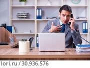 Купить «Young male employee being fired from his work», фото № 30936576, снято 17 апреля 2019 г. (c) Elnur / Фотобанк Лори