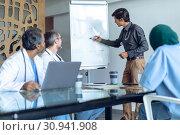 Купить «Male doctor explaining over flip chart in meeting at hospital», фото № 30941908, снято 10 марта 2019 г. (c) Wavebreak Media / Фотобанк Лори