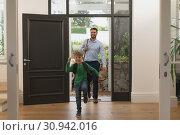 Купить «Father and son entering in a comfortable home », фото № 30942016, снято 12 марта 2019 г. (c) Wavebreak Media / Фотобанк Лори