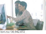 Купить «Female graphic designers discussing on computer at desk in a modern office», фото № 30942872, снято 16 марта 2019 г. (c) Wavebreak Media / Фотобанк Лори