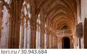 Купить «Strict architecture of cloister gallery with Gothic ogival spans of Monastery of Santa Maria de Santes Creus, Catalonia, Spain», видеоролик № 30943684, снято 11 февраля 2019 г. (c) Яков Филимонов / Фотобанк Лори