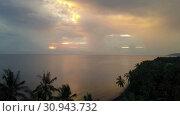 Купить «Aero view from drone of dawn of sun over sea through palm trees on beach, Bali, Indonesia», видеоролик № 30943732, снято 9 июня 2009 г. (c) Куликов Константин / Фотобанк Лори