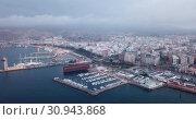 Купить «Aerial panorama of Almeria cityscape and vessels in harbor, Spain», видеоролик № 30943868, снято 18 апреля 2019 г. (c) Яков Филимонов / Фотобанк Лори