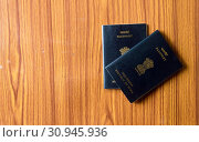 Купить «Indian Passport book on wooden table hardwood floor. Close up. Travel tourism and holiday vacation concept. Mockup. Top high angel view object with clipping path. Flat Lay. Copy space room for text», фото № 30945936, снято 21 марта 2019 г. (c) easy Fotostock / Фотобанк Лори