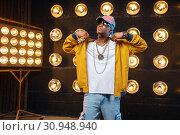 Купить «Black rapper in cap, perfomance on stage», фото № 30948940, снято 5 апреля 2019 г. (c) Tryapitsyn Sergiy / Фотобанк Лори