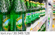 Купить «Russia Samara June 2019: bottles with pure fresh mineral water Narzan on the counter in the supermarket. Text in Russian: Ribbon, water, mineral, natural, curative, carbonated, Narzan», фото № 30949128, снято 5 июня 2019 г. (c) Акиньшин Владимир / Фотобанк Лори