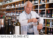 Купить «Winemaker checking wine in store», фото № 30949472, снято 8 мая 2019 г. (c) Яков Филимонов / Фотобанк Лори