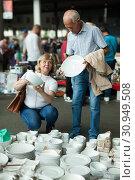 Купить «Mature family couple choosing vintage dishes on street market», фото № 30949508, снято 11 мая 2019 г. (c) Яков Филимонов / Фотобанк Лори