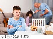 Купить «Son suffering from parents conflicts», фото № 30949576, снято 23 мая 2019 г. (c) Яков Филимонов / Фотобанк Лори