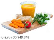 Купить «Freshly squeezed carrot-ginger juice», фото № 30949748, снято 26 мая 2020 г. (c) Яков Филимонов / Фотобанк Лори