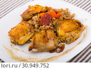 Купить «Photography of plate with fried chicken wings with barley porridge», фото № 30949752, снято 2 июля 2018 г. (c) Яков Филимонов / Фотобанк Лори