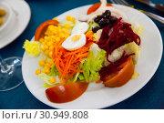 Купить «Mixed salad with eggs, fresh vegetables and boiled beet», фото № 30949808, снято 24 июня 2019 г. (c) Яков Филимонов / Фотобанк Лори