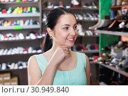 Купить «Ordinary woman that is looking on shelves», фото № 30949840, снято 10 мая 2017 г. (c) Яков Филимонов / Фотобанк Лори