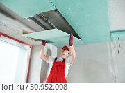 Купить «gypsum plasterboard construction work at suspended ceiling», фото № 30952008, снято 15 мая 2019 г. (c) Дмитрий Калиновский / Фотобанк Лори