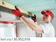 Купить «gypsum suspended ceiling construction work. quality control», фото № 30952016, снято 15 мая 2019 г. (c) Дмитрий Калиновский / Фотобанк Лори