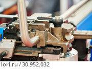 Купить «tube bending. industrial bender equipment machine for metal pipe bending.», фото № 30952032, снято 28 мая 2019 г. (c) Дмитрий Калиновский / Фотобанк Лори