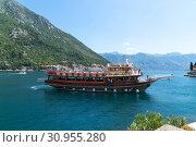 Купить «Perast, Montenegro - June 10. 2019. Beautiful excursion boat in a Boka-Kotorska bay», фото № 30955280, снято 10 июня 2019 г. (c) Володина Ольга / Фотобанк Лори