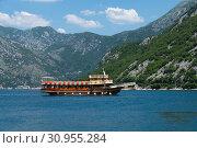 Купить «Perast, Montenegro - June 10. 2019. Beautiful excursion boat in a Boka-Kotorska bay», фото № 30955284, снято 10 июня 2019 г. (c) Володина Ольга / Фотобанк Лори