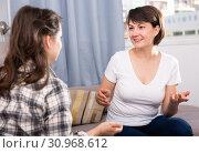 Купить «Mature woman and female friend talking at sofa at home», фото № 30968612, снято 19 июня 2019 г. (c) Яков Филимонов / Фотобанк Лори